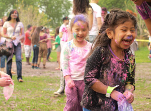 An off-season Holi celebration draws out a large crowd in Minneapolis's Powderhorn Park.