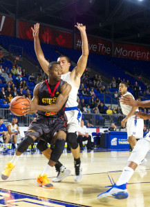 Guelph's Andrew Grant attempts to penetrate a tough UBC defence in the second quarter of their season opener. Despite a late surge, UBC managed to hold on for a 79-68 victory.