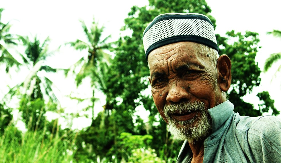 A local man rural Aceh, Sumatra, sets off on the return journey to his home.